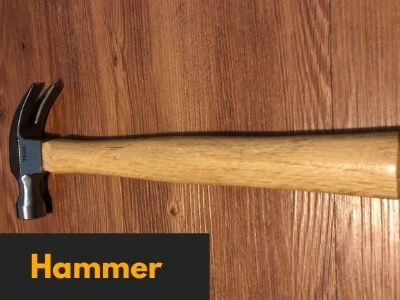 claw hammer for driving nails into pumpkin