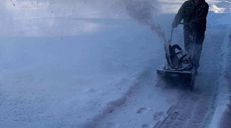 snow blowing a drive way